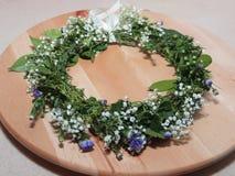 Hair Wreath. A handmade hair wreath made from baby's breath & purple flowers Royalty Free Stock Image