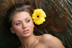 Hair yellow flowers Royalty Free Stock Photo