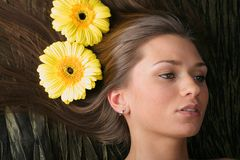 Hair yellow flowers Royalty Free Stock Images