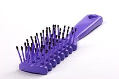 Hairbrush. Isolated violet hairbrush Stock Photography