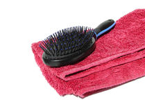 Hairbrush. On towel royalty free stock images