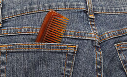 Hairbrush  in the back pocket of jeans Royalty Free Stock Photo