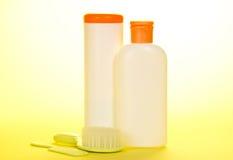 Hairbrush and cosmetics for newborns Stock Images