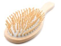 Hairbrush de madeira dado forma oval fotografia de stock