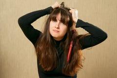 Hairbrush in female hair Royalty Free Stock Photos