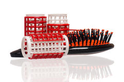 Hairbrush with hair curlers Stock Photography