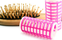 Hairbrush and hair-rollers Stock Photography