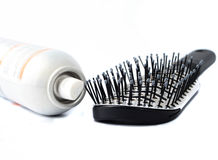 Hairbrush and hairspray royalty free stock photography