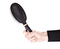 Hairbrush in hand isolated Royalty Free Stock Photo