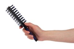 Hairbrush in a hand Royalty Free Stock Photo