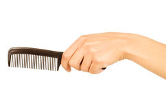 Hairbrush in the hand Royalty Free Stock Photo