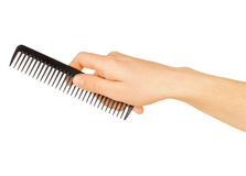 Hairbrush in the hand Royalty Free Stock Photography