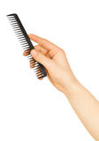 Hairbrush in the hand Stock Photography