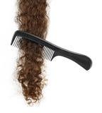 Hairbrush and lock of hair Royalty Free Stock Image
