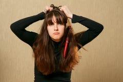 Hairbrush stucks in female hair Stock Photography