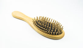 Hairbrush. Wooden old comb isolated on white background Stock Image