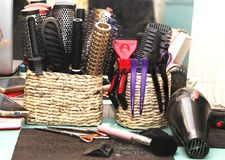 Hairbrushes, barrettes and hairdresser`s instructions in the salon royalty free stock photo