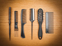 Hairbrushes on a wooden background.  Royalty Free Stock Images