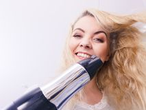 Woman drying hair in bathroom stock photography