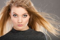 Attractive blonde woman with windblown hair Stock Images