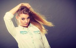 Attractive blonde woman with windblown hair Stock Image