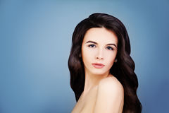 Haircare Concept. Healthy Brunette Girl with Long Brown Hair Stock Photos