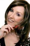 Haircare - fêmea que usa um hairbrush fotografia de stock