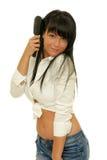 Haircare - femelle utilisant une brosse à cheveux Photos stock