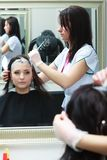 Woman getting hair colored in beauty salon Stock Photos