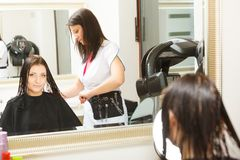 Woman getting hair cut in a beauty salon Royalty Free Stock Photo