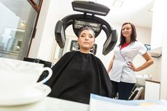 Woman in hairdresser, drying hair under machine Royalty Free Stock Photo