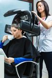 Woman in hairdresser, drying hair under machine Royalty Free Stock Photos