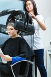Woman in hairdresser, drying hair under machine Stock Photos