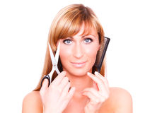 Haircut. Female cutting and beautifying herself Royalty Free Stock Photos