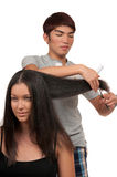Haircut. Young women having a haircut stock photos