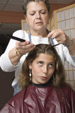 Haircut 5. Young girl getting her hair done at the salon Stock Image