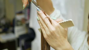 A haircut client`s hair in beauty salon stock video footage