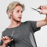 Man with scissors for haircutting Stock Images