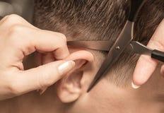 Haircut ear in a beauty salon Stock Image