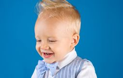 Haircut that is easy to manage. Boy child with stylish blond hair. Healthy haircare tips for kids. Little child with. Messy top haircut. Little child with short stock photography