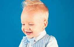 Haircut that is easy to manage. Boy child with stylish blond hair. Healthy haircare tips for kids. Little child with. Messy top haircut. Little child with short stock image