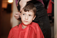 Haircut for little caucasian boy Royalty Free Stock Image