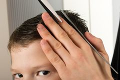 Haircut short hair bangs the boy, close - up stock photography