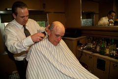 Haircut at the Troop Train. Photographer Joseph Sohm gets haircut in barbershop of Pearl Harbor Day Troop train reenactment from Los Angeles Union Station to San Royalty Free Stock Photos
