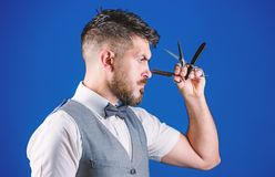 Haircuts and shaves. Bearded man with razor and scissors in retro barbershop. Hipster with beard in razor barber shop royalty free stock images