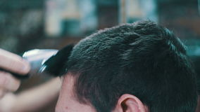 Haircutter Cuts Young Man with Clipper stock video