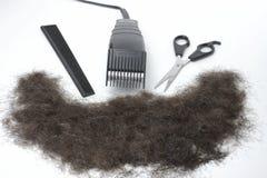 Haircutting Ausrüstung und Haar 1 Stockbilder