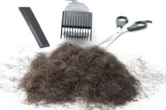 Haircutting Hilfsmittel und Haar 2 Stockfotos