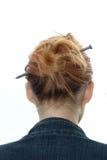 Hairdress con un chiodo del metallo Immagine Stock