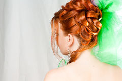 Hairdress of the girl behind. With red hair Stock Images